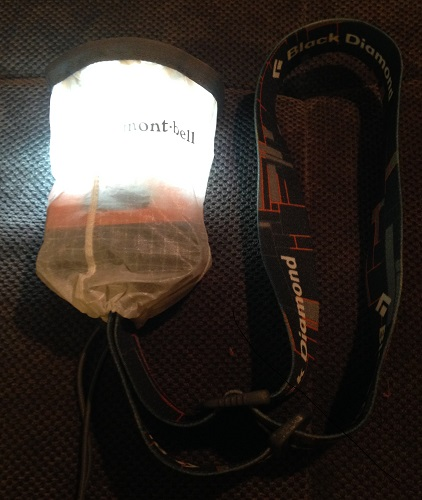 The Mont-Bell Crushable Lantern Shade attached to my Black Diamond Storm headlamp.