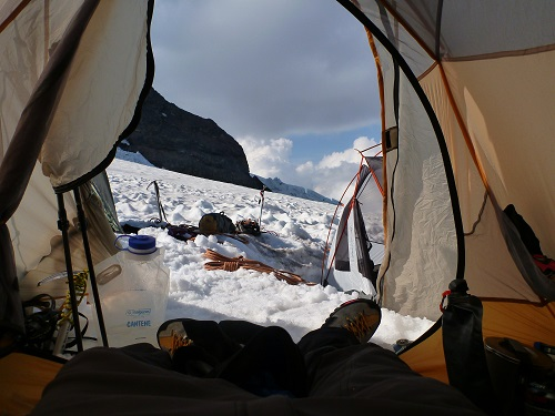 Hanging out in my securely anchored tent at Ingraham Flats on Mt. Rainier.