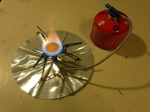 The Olicamp Xcelerator Titanium stove when lit.